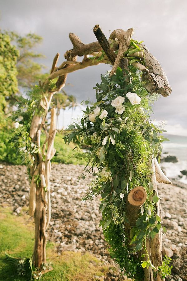 Driftwood Floral Arch | Retro Tropical Hawaii Wedding from Jessica Beneteau of Anna Kim Photography