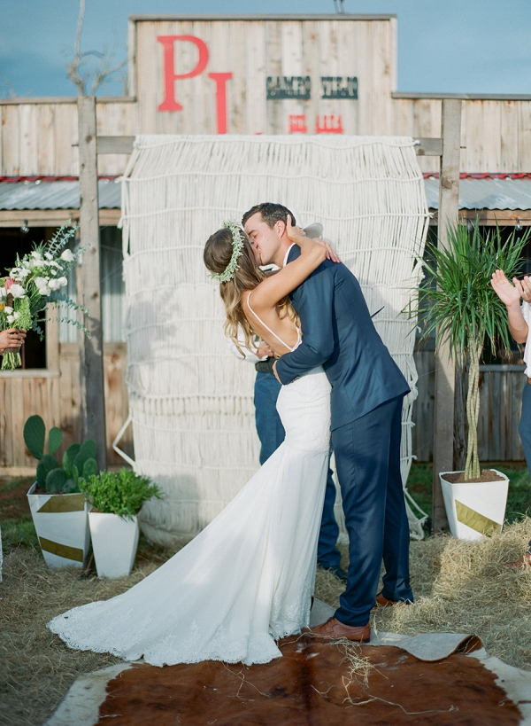 Bride and Groom Kissing During Ceremony | Bohemian Ranch Wedding By Alyssa Nikole Photography