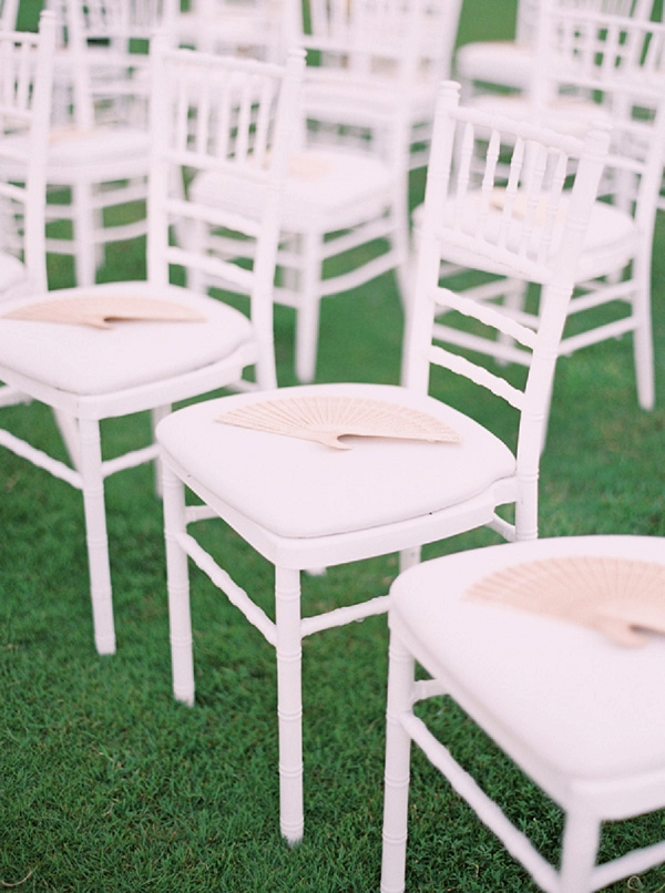 Ceremony Seating with Fans for the Guests | Glamorous Punta Cana Wedding By Melissa Jill Photography