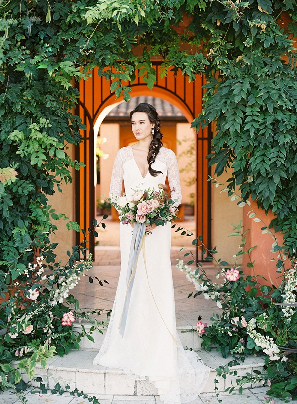 Bride framed by Beautiful Greenery   Villa Di Baci Editorial from Lynette Boyle Photography