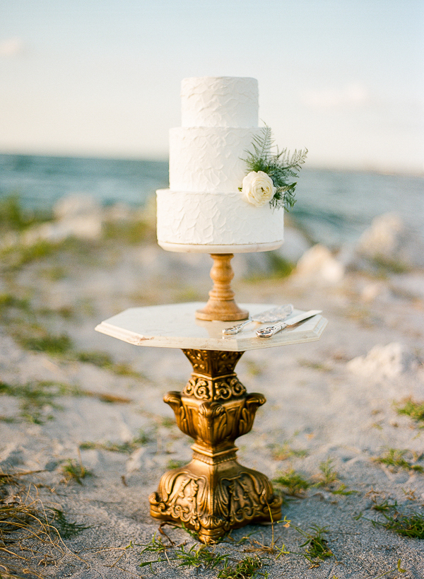 Coastal Inspired Wedding Cake on Beautiful Stand | Romantic Beach Wedding Inspiration by The Ganeys