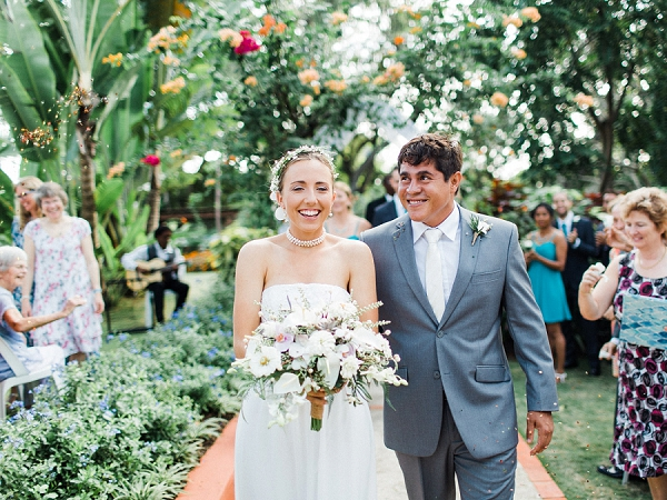 Bride and Groom Walking Down The Aisle and Petal Toss | Colourful Backyard Barbados Wedding by Corynn Fowler Photography