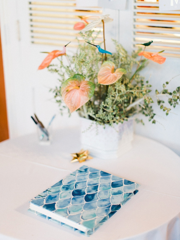 Wedding Guest Book and Tropical Centerpiece | Colourful Backyard Barbados Wedding by Corynn Fowler Photography
