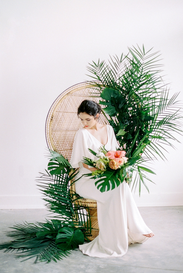 Wedding Fan Chair with Lush Foliage | Indoor Tropical Wedding Inspiration by Kerry Jeanne Photography