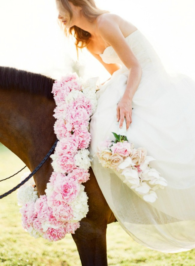 Bride-on-Horse-with-Pink-Flowers