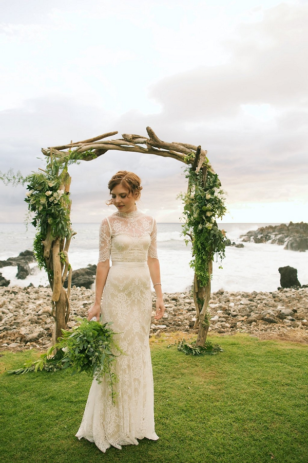 Bride and Driftwood Floral Arch | Retro Tropical Hawaii Wedding from Jessica Beneteau of Anna Kim Photography
