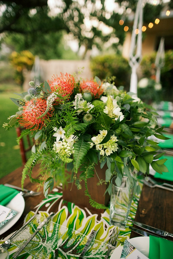 Tropical Floral Centerpiece | Retro Tropical Hawaii Wedding from Jessica Beneteau of Anna Kim Photography