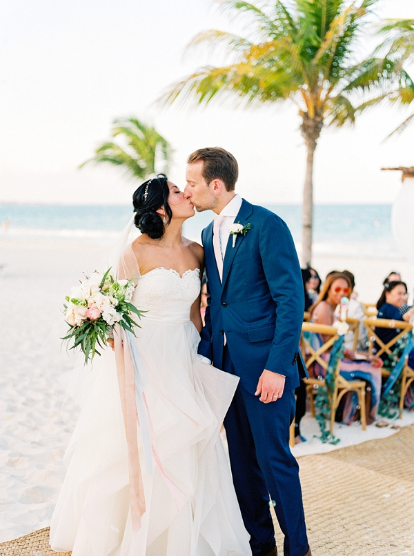 Bride and Groom Kissing At The End Of The WWalk Down The Aisle | Colorful Destination Wedding In Mexico By Brittany Lauren Photography