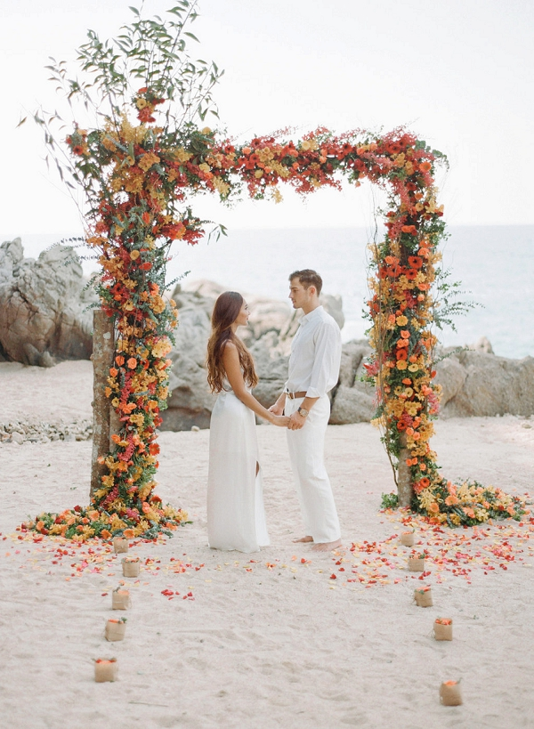 Gorgeous Floral Beach Wedding Arch   Tropical Luxe Wedding Inspiration in Thailand from Megan W Photography