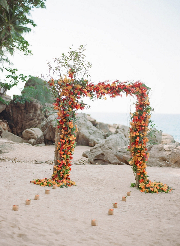 Floral Beach Wedding Arch   Tropical Luxe Wedding Inspiration in Thailand from Megan W Photography