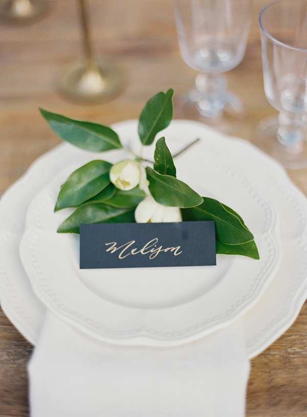 Place Setting with Calligraphy Place Card and Magnolia Blooms | Classic Wedding Inspiration By Rachel May Photography