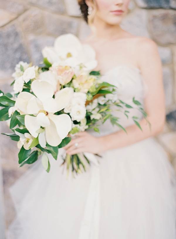 Bride and Wedding Bouquet with Magnolias | Classic Wedding Inspiration By Rachel May Photography