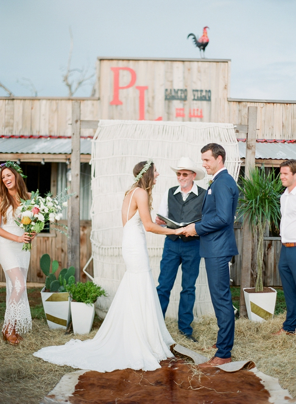 Bride and Groom Exchanging Vows | Bohemian Ranch Wedding By Alyssa Nikole Photography