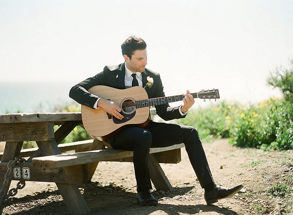 Groom Playing on Guitar | Out Of Water Malibu Inspiration by Bonphotage Photography