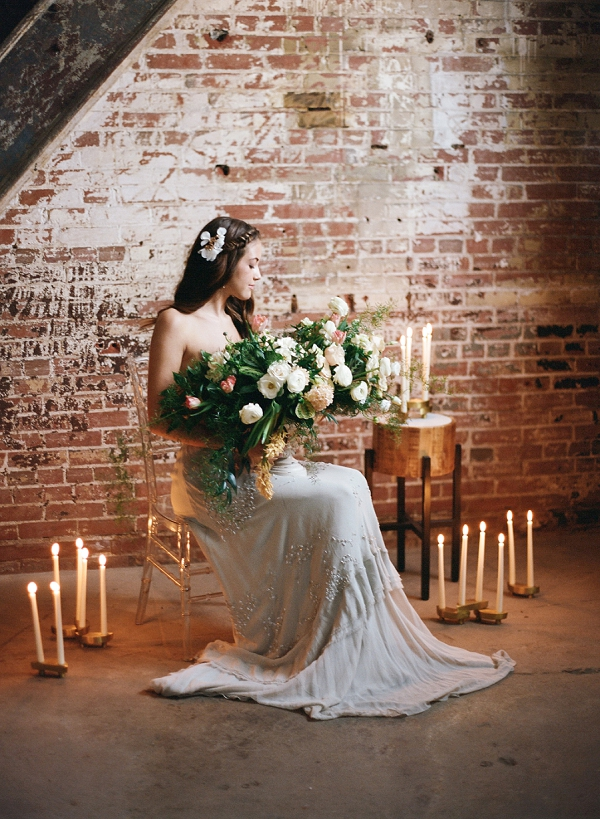 Bride with Centerpiece | Graceful Industrial Wedding Inspiration by Lauren Field Design and Lisa Hessel Photography
