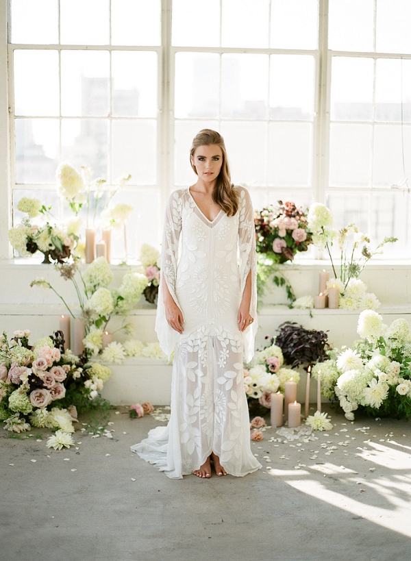 Bride with Flower Filled Backdrop | Floral Inspired Wedding Ideas from Kristen Beinke Photography