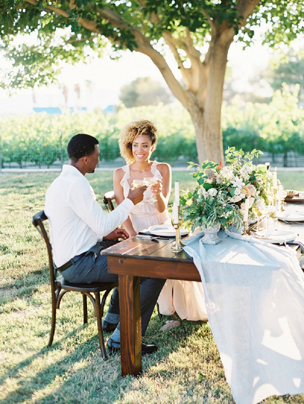 Bride and Groom before an Elegant Tablescape | Romantic Vineyard Elopement Inspiration by Gaby J Photography