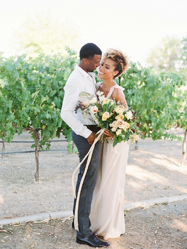 Bride and Groom with Ribbon Tied Bouquet | Romantic Vineyard Elopement Inspiration by Gaby J Photography