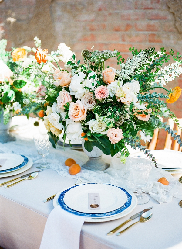 Tablescape with Peach Orange and Cobalt Blue Hues   Summer Wedding Inspiration With An Industrial Vibe from Kate Pease Photography and Grit + Gold Weddings