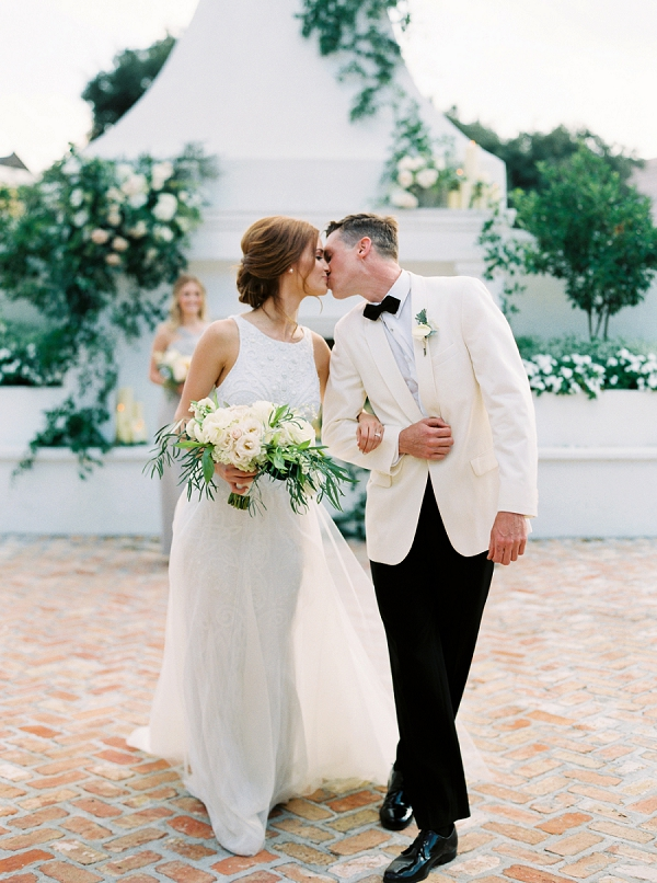 Bride and Groom Kissing At End Of The Aisle | Elegant and Organic Wedding Ideas by Elyse Jennings Weddings and Greer Gattuso Photography