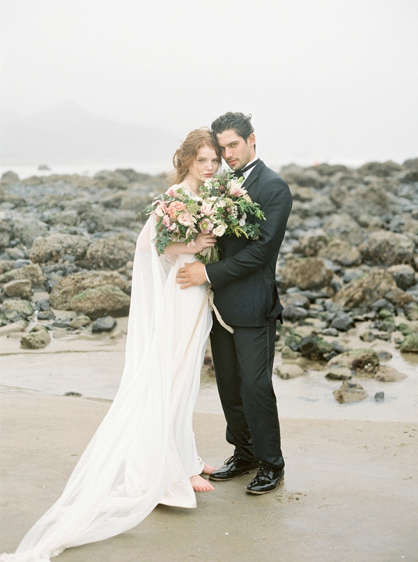Bride and Groom on the Beach | Rainy Day Elopement Inspiration by Tracy Enoch Photography and Query Events