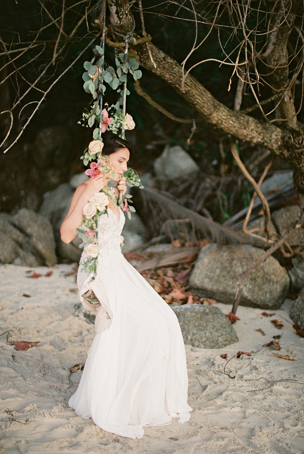 Bride on Floral Swing Portrait | Tropical Elopement Inspiration by Steve Torres Photography