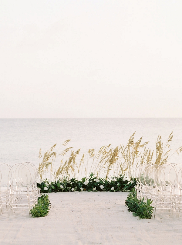 Organic Ceremony Backdrop and Ghost Chairs | Tropical Beach Wedding Ideas By Simply Sarah Photography