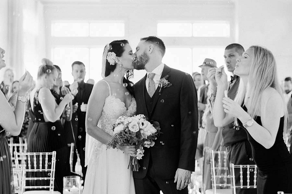 Bride and Groom Kiss | Chic Art Deco Miami Wedding By Merari Photography