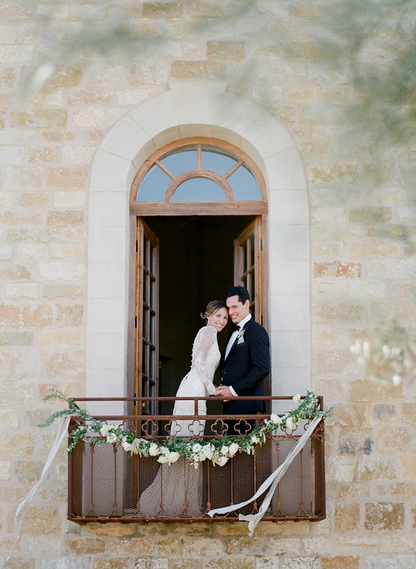 Bride and Groom on the Balcony   European Inspired Wedding Ideas With Old World Elegance by Jeanni Dunagan Photography