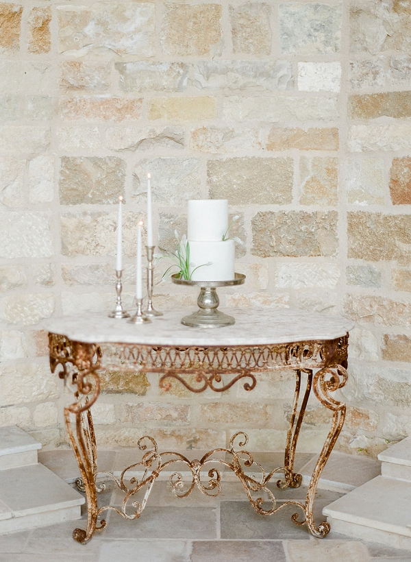 Wedding Cake on Vintage Table   European Inspired Wedding Ideas With Old World Elegance by Jeanni Dunagan Photography