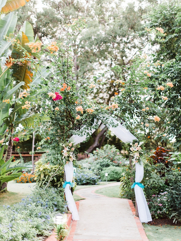 Wedding Arch with Draping | Colourful Backyard Barbados Wedding by Corynn Fowler Photography